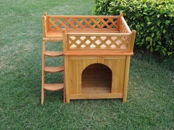 Дерев`яний котячий будиночок з терасою, фото з сайту http://learichard.files.wordpress.com